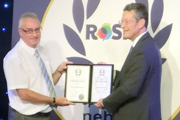 Billy Vance collecting ROSPA awards